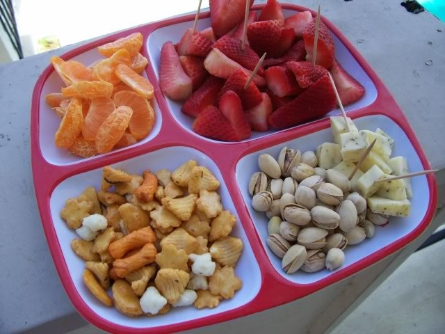 a ton of good snack ideas:  Monkey Platters—Finger-food for Kids