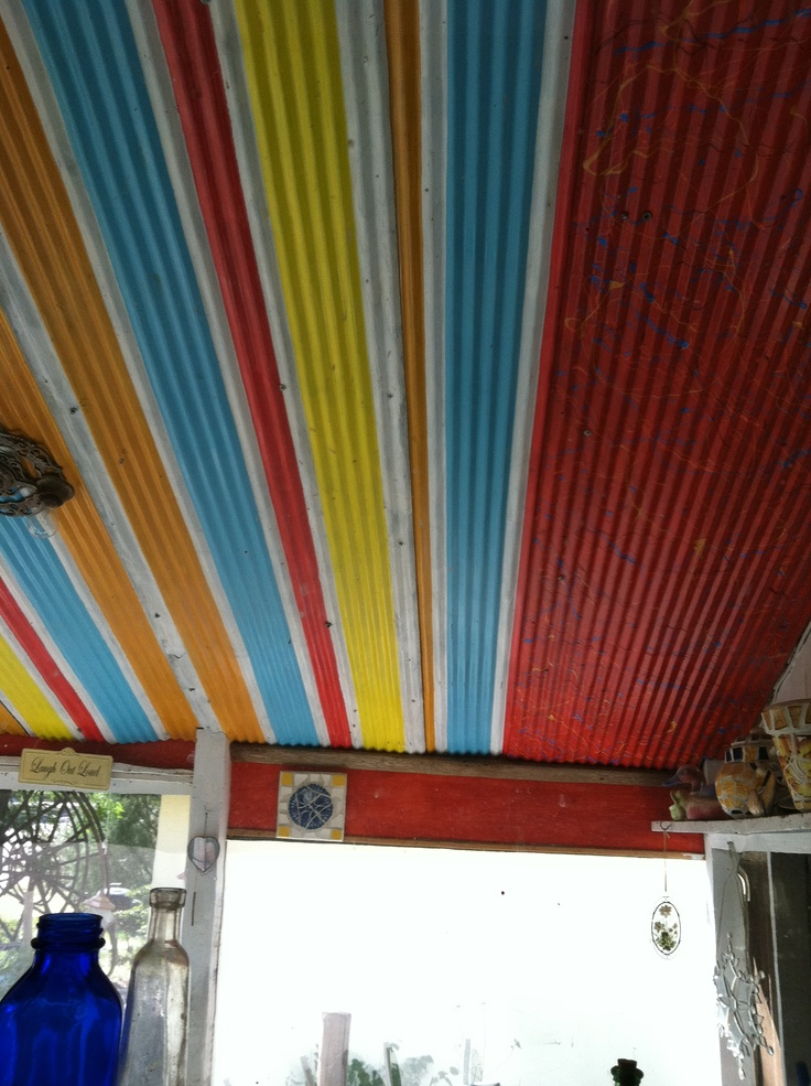 I painted old corrugated metal found in a salvage yard with oil based paint and hung it on my