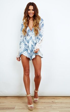 This boho playsuit in a gorgeous pastel blue print is the ideal summer outfit. The crochet material gives it a timeless vintage look making it perfect for your next festival. Shop Now.