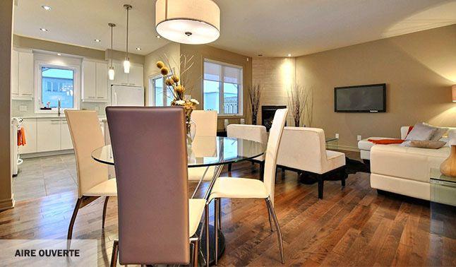 Espace de vie à aire ouverte, moderne et idéale pour la famille.