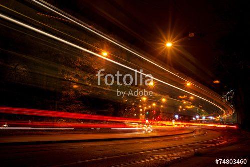 """Laden Sie das lizenzfreie Foto """"Stadtverkehr bei Nacht"""" von Photocreatief zum günstigen Preis auf Fotolia.com herunter. Stöbern Sie in unserer Bilddatenbank und finden Sie schnell das perfekte Stockfoto für Ihr Marketing-Projekt!"""