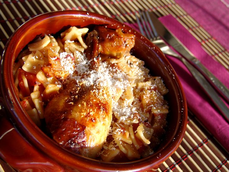 Chicken cooked in a rich tomato sauce with noodles is a tasty dish and so easy to make.              Ingredients:4 chicken thighs1 onion grated1 large clove of garlic minced3 tomatoes chopped up or 1