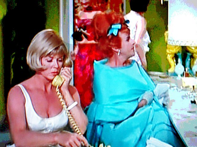 """Ms. Day has got the correct 'number' on actor/detective-in-drag Paul Lynde in the Ladies Room in her hilarious 1966 hit comedy film, """"The Glass Bottom Boat."""" Lynde almost steals the scene from her here as he is resplendent in aquamarine satin."""
