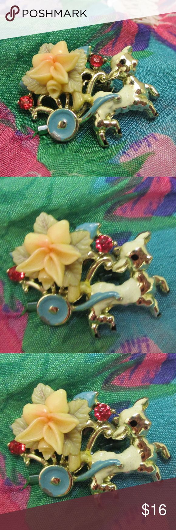 """Lamb Flower Cart Vintage Pin Colorful 1950s Presenting a precious lamb pulling flower cart vintage pin brooch. Silver tone metal, blue, white and black enamel, plastic resin pink/cream flower and faceted ruby crystal rhinestones adorn this 1950s figural lamb piece. Dimensional resin flower gives depth to this charming animal and cart brooch.  1 1/2"""" x 1"""" x 3/8"""" deep.  Secure rollover clasp. EUC - polish to satisfaction. Perfect for spring, Easter, to gift a special girl or woman or to add to…"""