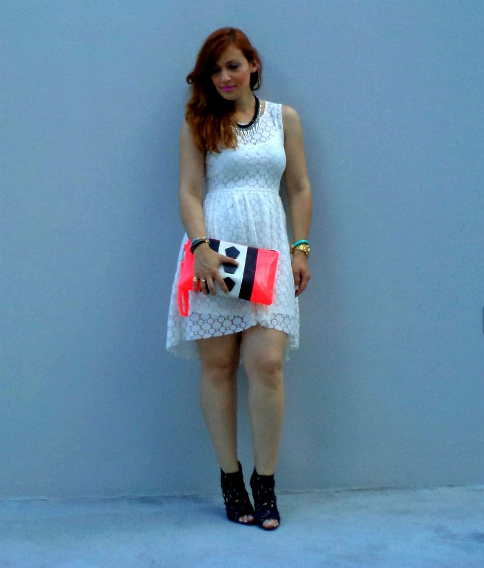 Bad Romance wearing #HM lace dress & graphic clutch with #misssixty black high heels.