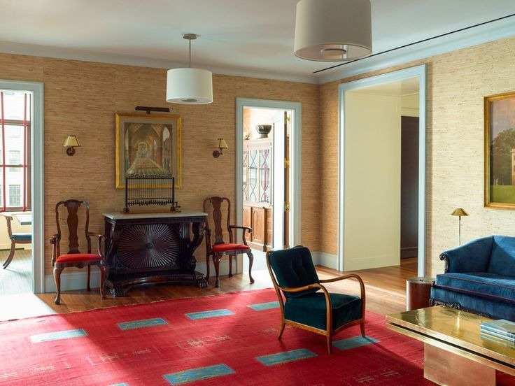 Architect Anton Gilkin's 2014 watercolor of the firm's proposal for the New York Public Library hangs in the reception area; the Queen Anne chairs belonged to Pennoyer's father, and the flat-weave carpet was purchased on a trip to Marrakech in the late 1990s.