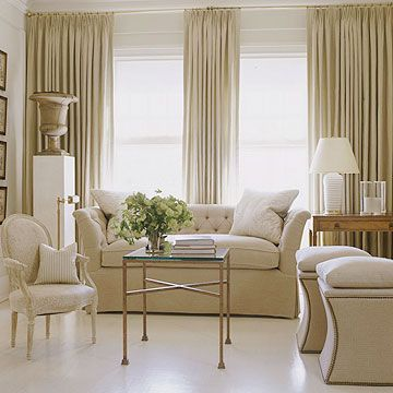 Simple and  Spectacular. By hanging the panels from floor to ceiling and overlapping the edges of the window trim, this treatment is ideal for camouflaging mis-matched window sizes -- and concealing uneven wall surface
