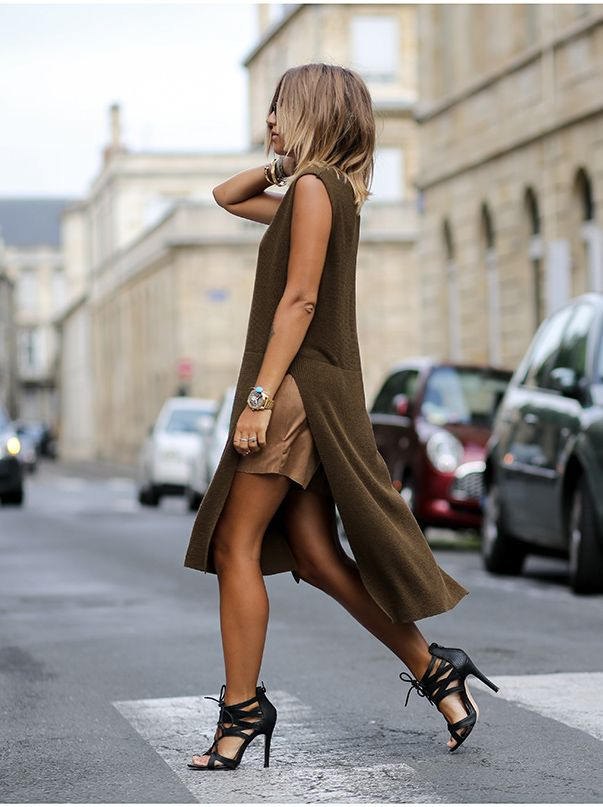 justthedesign:  High slit layers are definitely in - why not wear one over a tan mini skirt with black heels. Via Camille Callen  Dress: Zara, Sirt: Jennyfer, Shoes: Jennyfer