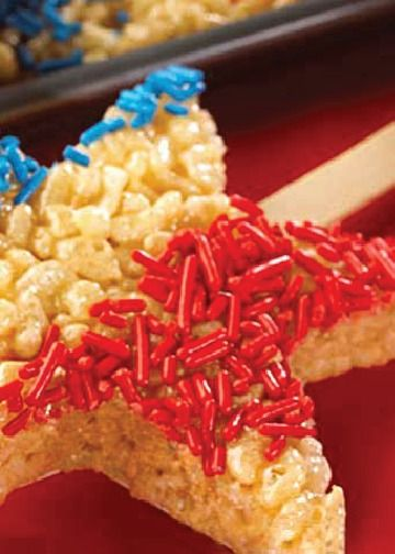 Decorate a full pan of Rice Krispies Treats® with stripes and sprinkles. Then help your kids cut out star shapes and pop them right onto sticks for a patriotic snack on the go. Pin and save this for the 4th of July!