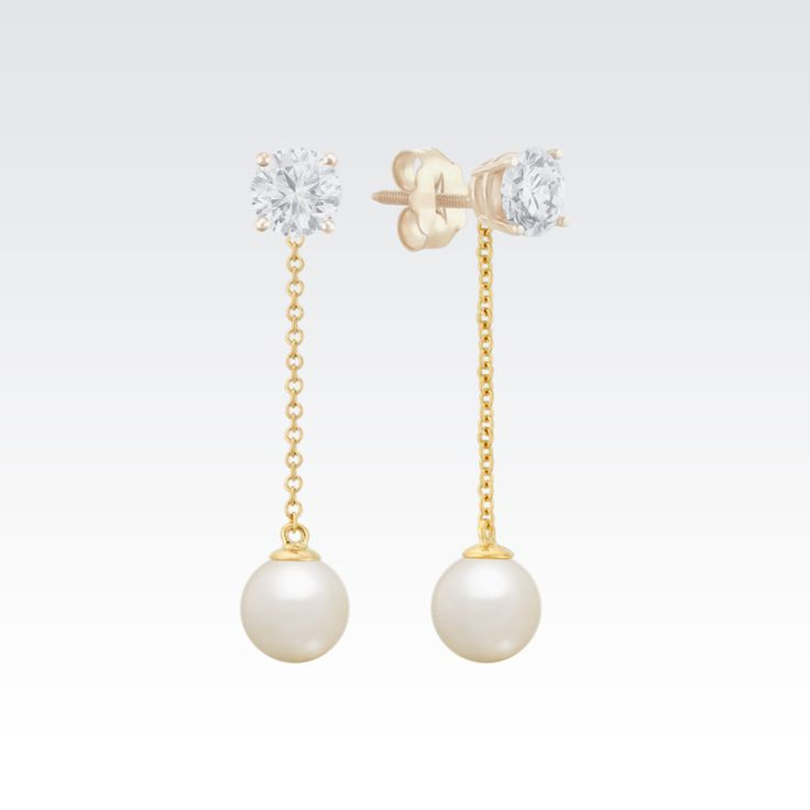 Create a whole new look for your solitaire earrings with these stunning pearl earring jackets. Two 6.5-7mm cultured freshwater pearls dangle from chains of quality 14 karat yellow gold. Simply place the post of any size of solitaire earrings through the hole at the top of the earring jackets and you have a great new pair of dangling earrings!  The diamond solitaire earrings are not included.