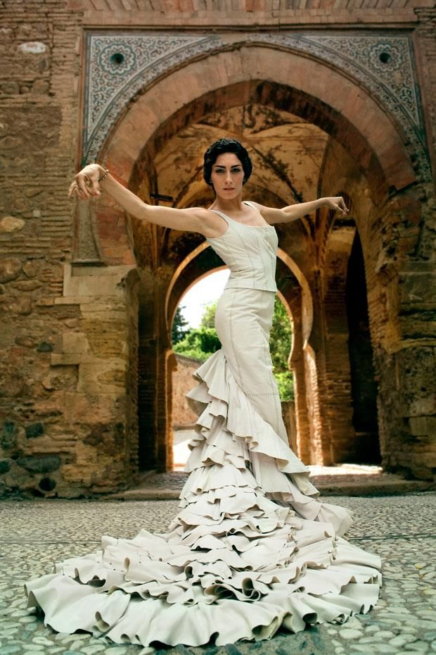 flamenco dancer wearing a bata de cola - if I ever wore a wedding dress this would be it
