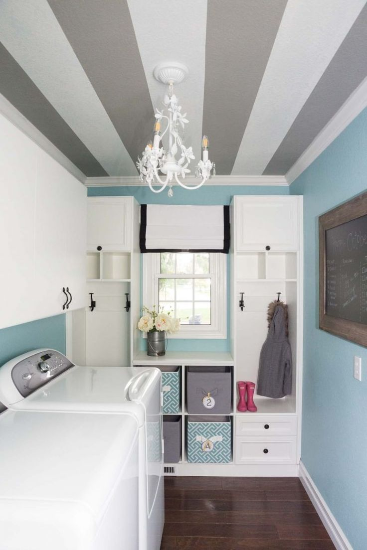 Paired with soft Tranquil Aqua SW 7611 walls, this striped ceiling (Extra White SW 7006 and Dorian Gray SW 7017) is a creative inspiration.