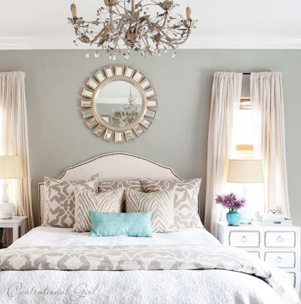 I love the color of the walls, the decorative mirror, the colors on the bed with the pillow for a pop of color!