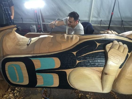 Moy Sutherland's Carvings Painting on a totem pole