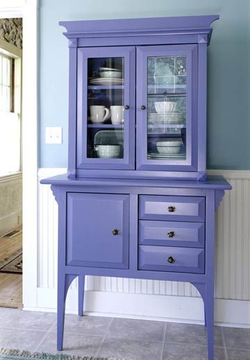 A smaller hutch may still provide enough storage in your kitchen and can be easily moved to a different room whenever desired. This blue hutch exudes a cottage-like appearance, and adds to the decor of the room. The color fits in beautifully with the blue-and-white color scheme on the walls and tiled floors. Solid doors below create hidden storage space, while the glass doors on top allow for an attractive display of china.