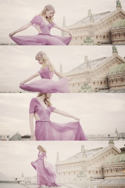 Taylor wearing a purple dress in the Begin Again music video.