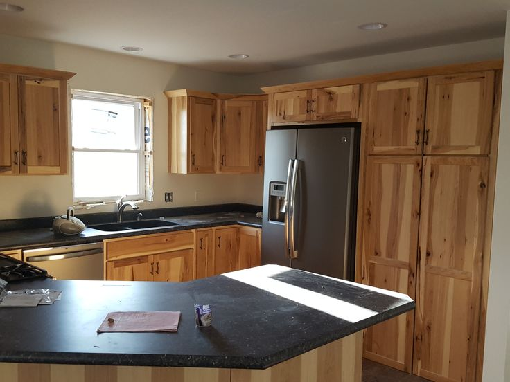 Rustic Hickory Cabinets, black laminate countertops, GE slate appliances