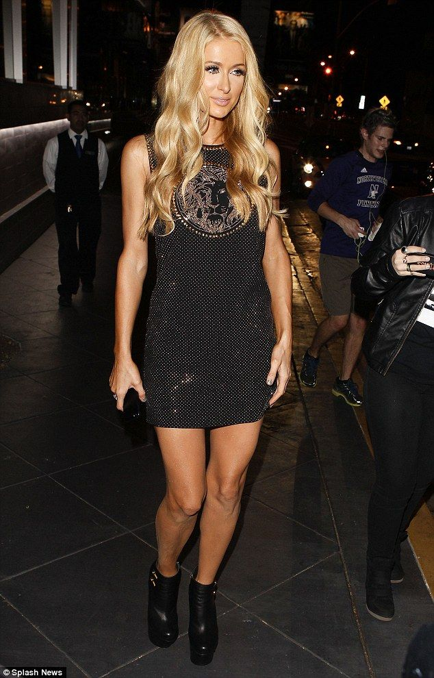 Ready for her big night: Paris Hilton chooses stunning Versace dress and and towering platform boots as she celebrates her new single releas...