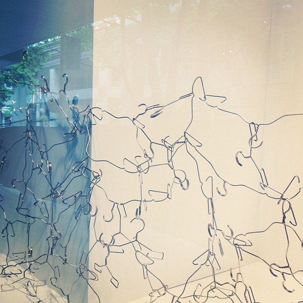 Cool window display using hangers. by papernstitch, via Flickr