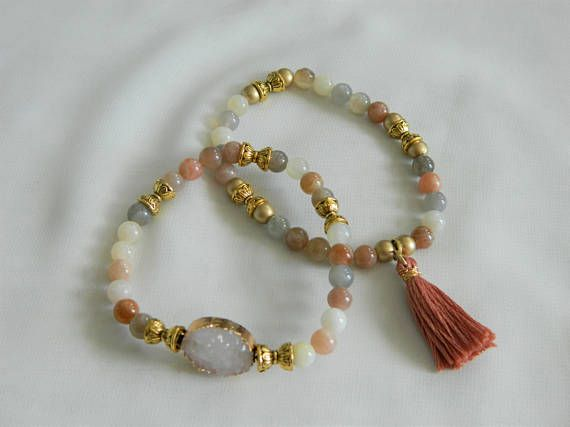 A set of two handmade stretch bracelets: Druzy and tassel in