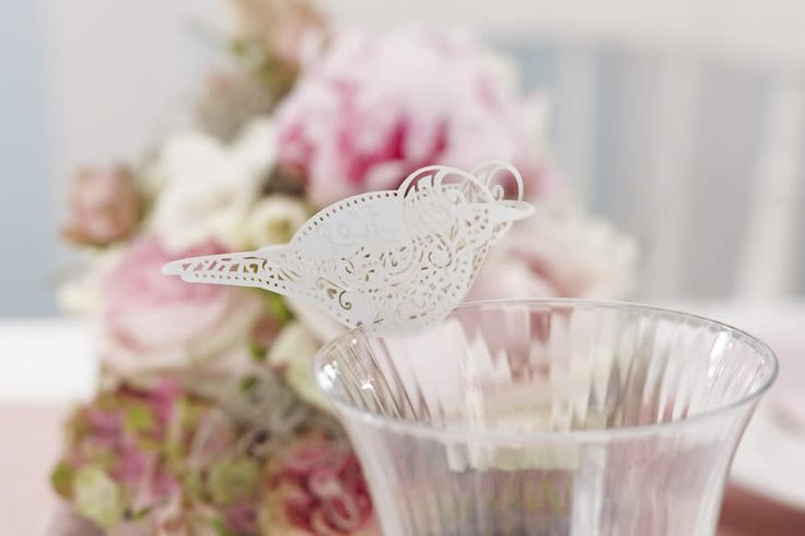 These beautiful laser cut birds balance on the edge of a drinking glass and can be used as unique place cards or elegant table decoration. A pretty touch to any table.Each pack contains 10 place cards.
