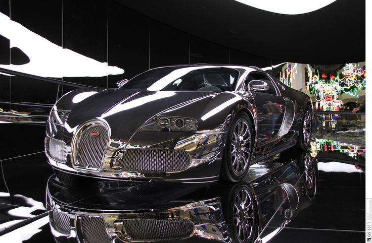 The Bugatti Veyron EB 16.4 is a mid-engined grand touring car. The Super Sport version is the fastest road-legal production car in the world, with a top speed of 431.07 km/h (267.85 mph).[4] The original version has a top speed of 408.00 km/h (253.52 mph).[5] It was named Car of the Decade (2000–2009) by the BBC television programme Top Gear.  Designed and developed by Volkswagen Group (based on the Bentley Hunaudieres concept) and produced by Bugatti Automobiles SAS at their headquarters…
