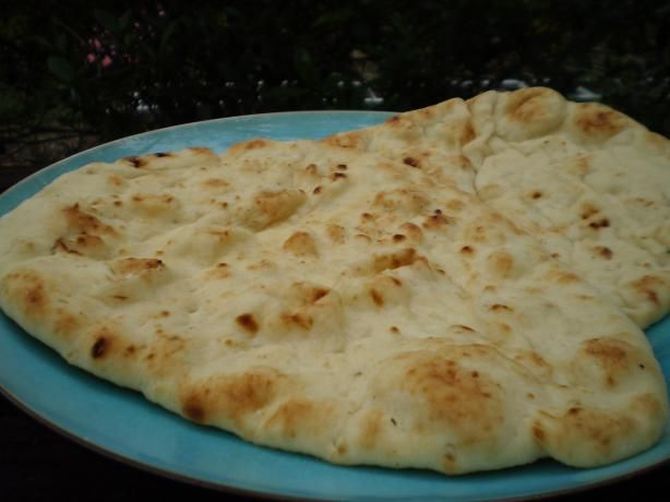 Original Indian Naan Bread from Food.com:   								Nann are eaten usally with curries. Naans comes in different flavors: plain naan, butter naan, garlic naan. Originally they are cooked in tandoor but you can prepare this in your chiken.  For prepaetion and more information look at http://www.vahrehvah.com/Naan+:3094