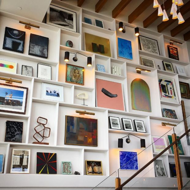 Soho House Malibu reviving charm. I love the gallery of art work on the wall.