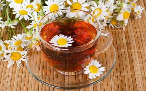 9 Amazing Health Benefits of Chamomile Tea (promotes sleep, soothes your stomach, calms muscle spasms, promotes healthy skin, treats cuts and wounds and may prevent cancer.)