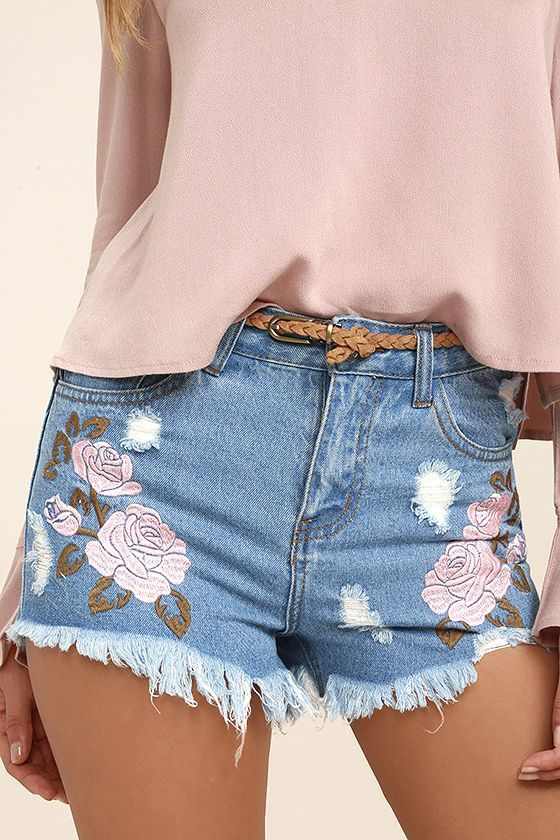 Put your unique style on display in the Posy Parade Light Wash Embroidered Distressed Denim Shorts! Light wash denim has a low-rise fit with top button, hidden zip fly, and a five-pocket cut. Pink and light brown floral embroidery trims the front, while distressing and frayed hems give these shorts a well-loved look.