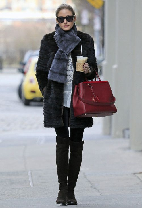 Olivia Palermo wearing Stuart Weitzman 5050 boots Fendi 2 Jours Elite bag Westward Leaning Children of California sunglasses  New York City April 7 2013