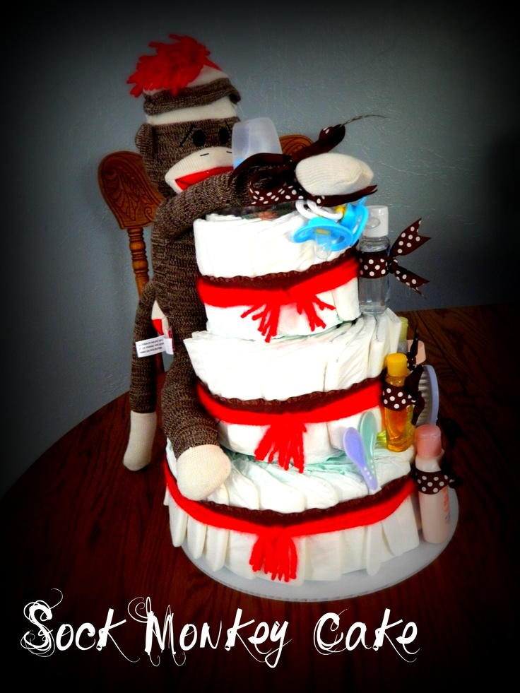 """Diaper cake, made with one pack of size 3 diapers, using the """"layered"""" look instead of the rolled.  Super Super easy and fast, made """"unisex"""" for a great gift"""