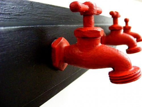 Wall hooks from faucets painted with your accent color!  What a fun, eclectic look for a bathroom.