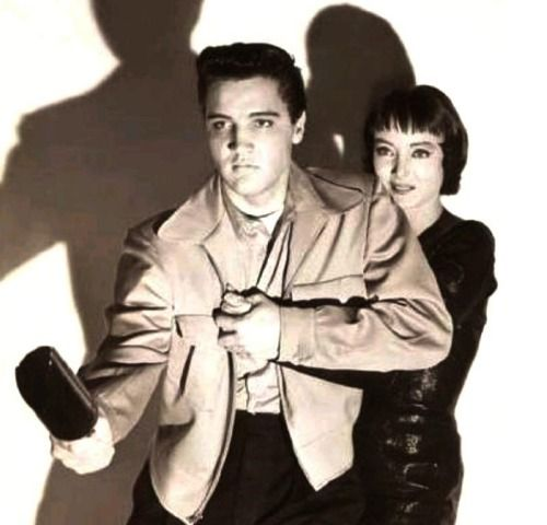 Elvis Presley as Danny Fisher and Carolyn Jones as Ronnie, Maxie's mistress in 'King Creole' (publicity pose) - 1958. Directed by Michael Curtiz and starring Walter Matthau, Dolores Hart and Dean Jagger. Based on the 1952 novel A Stone for Danny Fisher by Harold Robbins.