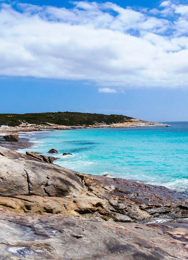 Arid Bay in Cape Arid National Park is near Esperance, Western Australia and features crystal blue waters against white sands and rocky outcrops. Find out more about the park at GetawayWA: http://wp.me/p8jF6B-2m