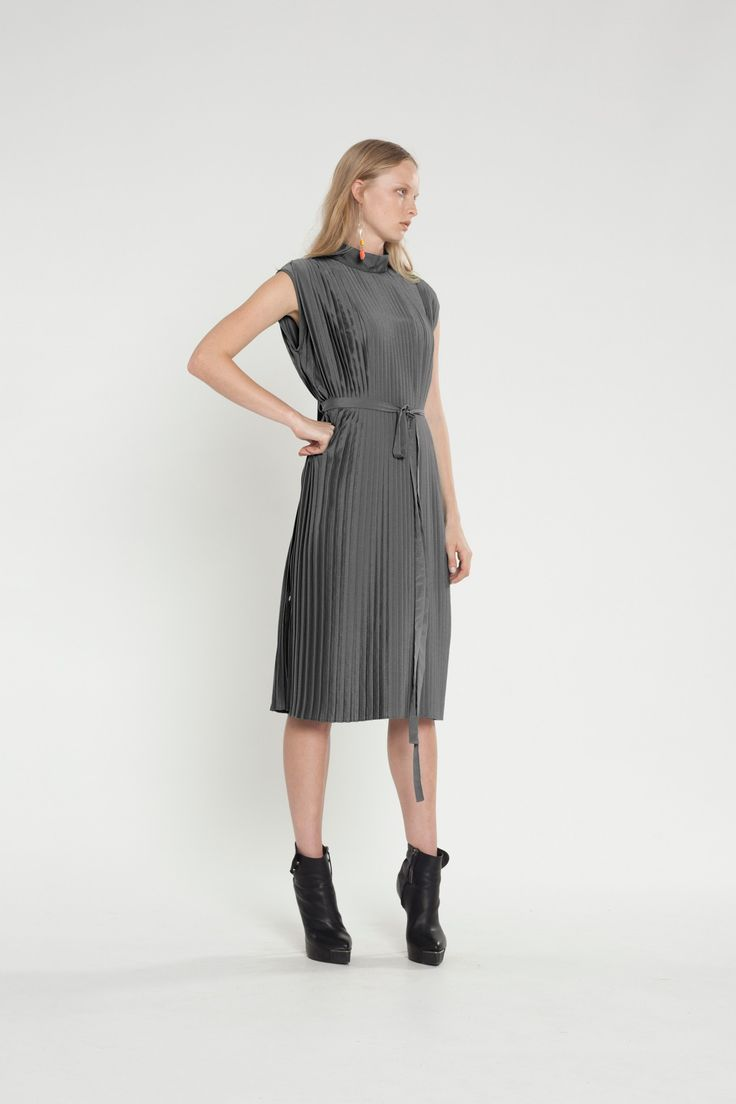 This pleated tunic is an edgy and easy piece featuring buttons and loops at the side seams, this piece can easily transform from a tunic to an evening dress. #fashion #dress #tunic #pleats #edgy #silver
