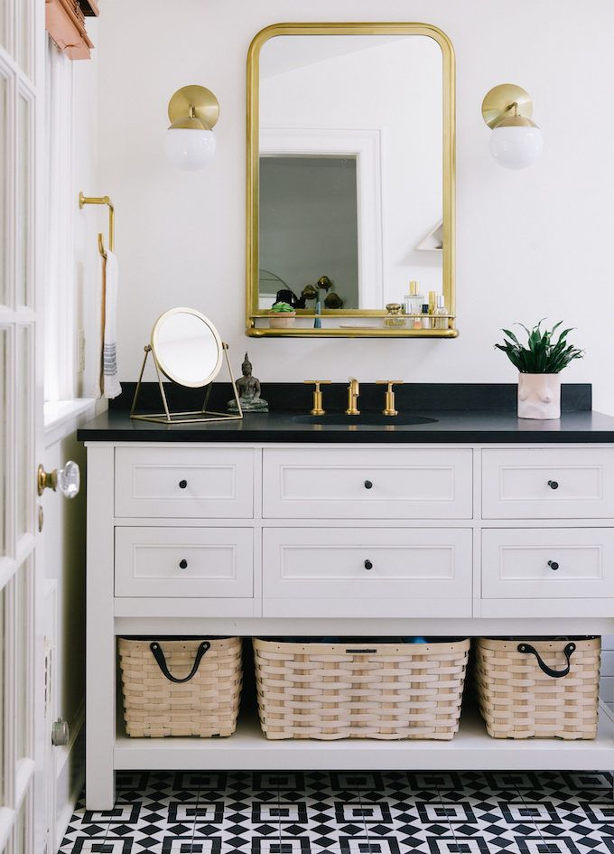 Beautiful master bathroom- love the mirror especially (and the black and whites of course)