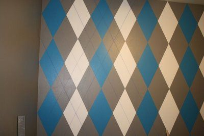 "Madelyn Ridgeway is awesome! She and her hubby painted their sons bedroom wall with an argyle pattern and she emailed me the directions for our readers! I'm loving this wall – can't wait to see the finished room! Here's the sweater vest that was the inspiration for the room. Madelyn: ""I originally painted the room..."