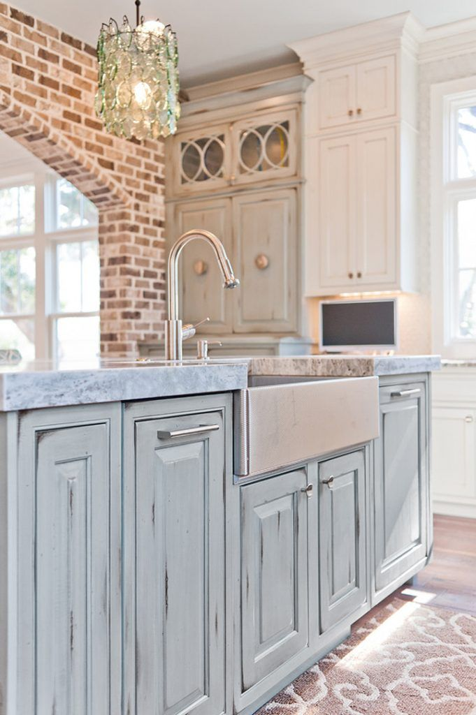 Dove Studio blue kitchen with exposed brick.(( love the blue cabinets with brick backslash)))