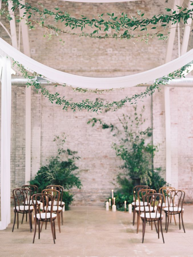 Indoor ceremonies can be glammed up with the use of plants, candles and decorative chair