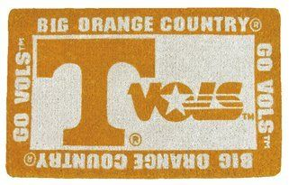 """Tennessee Volunteers Welcome Mat by Team Sports America. $33.89. Enviromentally safe product. Made of 100% coconut coir. Each mat features your favorite team's logo and a unique design that is featured in full color. Our large 18"""" x 30"""" team logo welcome mats have been uniquely crafted by skilled Indian artisans using centuries of old traditional methods. These licensed team logo mats are wholly natural products and are fully bio-degradable. NCAA Tennessee Volunt..."""