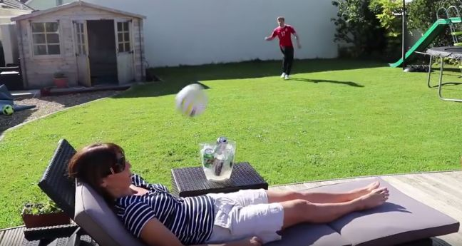 KID+DRILLS+MOTHER+IN+FACE+WITH+SOCCER+BALL+DURING+FAILED+TRICK+SHOT