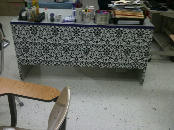 Boring metal teacher desk dressed up with wrapping paper