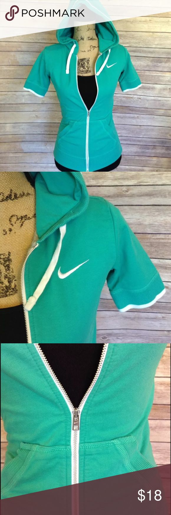 "Nike size XS green short sleeve zip up hoodie Pre-owned Nike women's size XS green short sleeve zip up hoodie. Excellent used condition. No rips holes or stains. 100% cotton.   Measurements:  Armpit to armpit- 15.5""  Armpit to sleeve- 4.5""  Length- 23.5""   I ship fast! Pay before 4:30pm Monday thru Friday and I will ship the same day!  Thank you for looking!  Check out my other items! Nike Jackets & Coats"