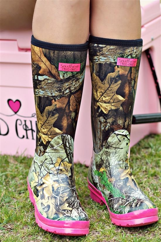 """Our adorable Pretty in Camo Boots are perfect for the country girl who loves a tiny bit of color with her camo! You can't go wrong with our camo boots! They have a black band around the top with the shaft of them in camo print, and the foot of the boot in a different pattern camo print. The bottom outsole is pink colored. There is a pink label on the front of the boot that says """"Southern Fried Chics"""". #southernfriedchics"""