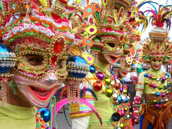 The MassKara Festival, also known as the Festival of Smiles, is a week-long celebration held in October each year in Bacolod City, Philippines. The festival features a street dance competition where people from all walks of life converge on the streets to see dancers in colorful, smiling masks gyrating to the rhythm of Latin musical beats in a display of mastery, gaiety, coordination and stamina.