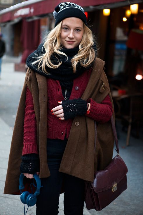 Shop this look on Lookastic:  http://lookastic.com/women/looks/beanie-scarf-cardigan-gloves-cape-coat-skinny-jeans-crossbody-bag/8081  — Black and White Print Beanie  — Black Knit Scarf  — Burgundy Knit Cardigan  — Black Wool Gloves  — Dark Brown Cape Coat  — Black Skinny Jeans  — Dark Purple Leather Crossbody Bag