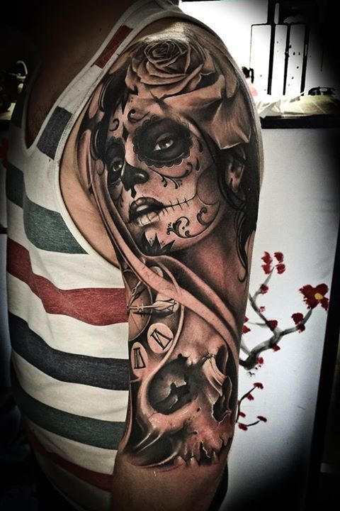 Arm sleeve Santa Muerte tattoo. Click for more Drop Dead Gorgeous Santa Muerte Tattoos.