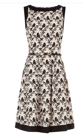 Love the shape, quirky pattern & high neck,