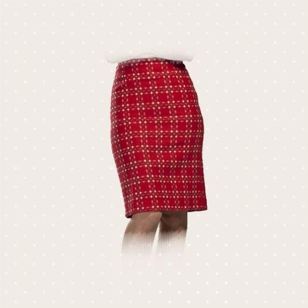 Gonna rossa a quadretti, calda e confortevole per il morbido tessuto in lana.
